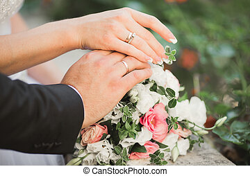 Wedding couple bride and groom holding hands