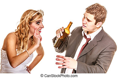 Wedding couple, bride with alcoholic drinking groom. -...
