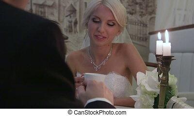 Wedding couple drinking coffee