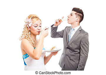 Wedding couple eating and drinking