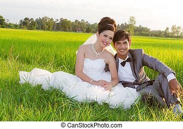 Wedding couple embracing each othe