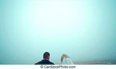 Wedding couple goes winter on Snowed Field Drone