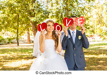 wedding couple holding hands in the word love