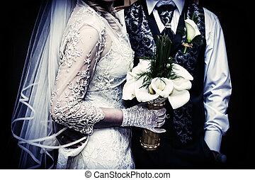Wedding couple holding hands