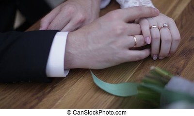 Wedding couple holding hands. Young married couple holding hands, ceremony wedding day