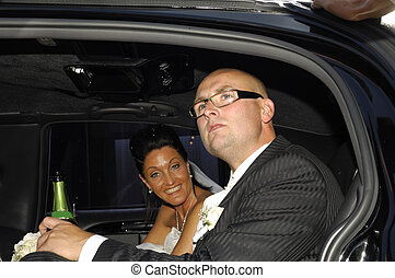 Wedding couple in car