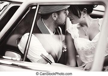 Wedding couple in car - Stylish Autumn wedding a beautiful...
