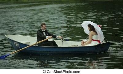 Wedding couple in rowboat