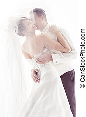 Wedding couple kissing and happy smiling. Bride portrait. Over white