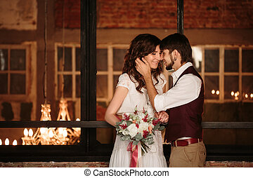 Wedding Couple Kissing in Loft Interior