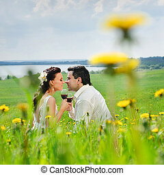Wedding couple kissing on a grass