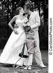 Wedding couple kissing - Bride and groom kissing for the...