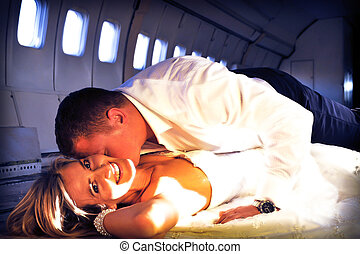 wedding couple laying in aircraft