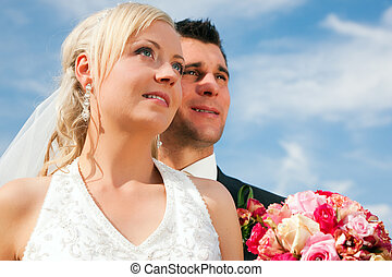 Wedding couple looking into future