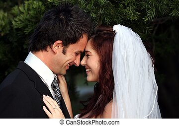 Happy wedding couple sharing an intimate moment