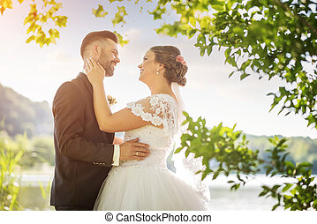 Wedding couple on beautiful nature.