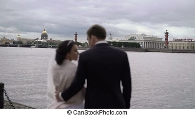 Wedding couple on embankment unrecognizable shot