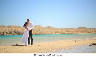 Wedding couple on the beach in Egypt. Exotic honeymoon
