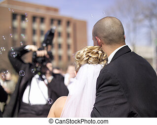 Wedding Couple - A bride and groom have their pictures taken...