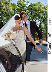 Wedding Couple Portrait with Limo - Happy newly wed couple...