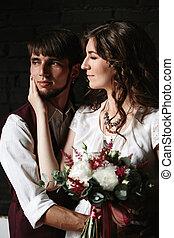 Wedding couple posing in the interior