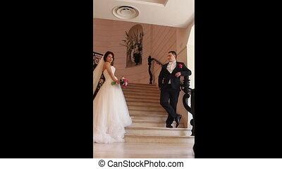 wedding couple posing near stairs. multiscreen