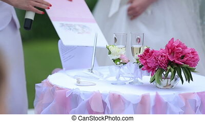 Wedding couple signaturing the marriage certificate. Wedding...