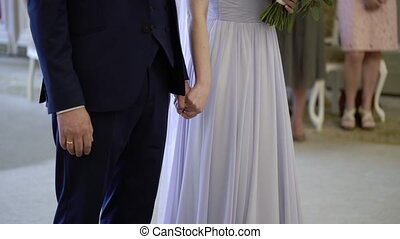 Wedding couple staying at ceremony indoors