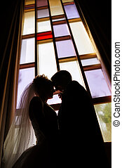 Wedding couple - Silhouette of wedding couple against...