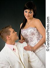 Wedding couple - Portrait of wedding couple. Bride wearing...
