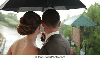Wedding couple under rain