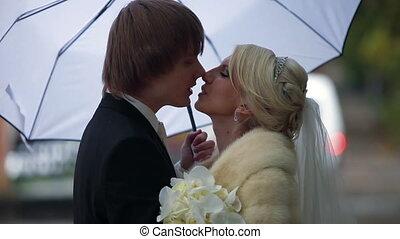 Wedding couple under white umbrella