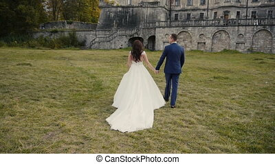 Wedding Couple Walking Before Castle