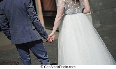 Wedding couple walking in a city