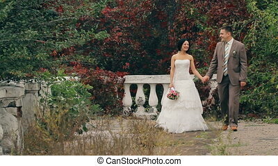 Wedding Couple Walking On Nature