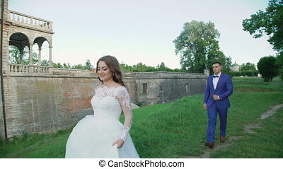 Wedding couple walks and poses near the ancient castle 4K