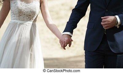 Wedding couple walks on a beach