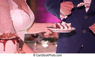 Wedding couple with piece of celebration cake