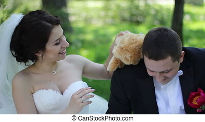 wedding couple with teddy bear