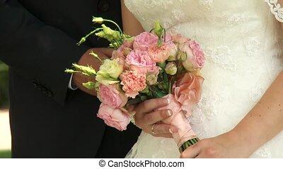Wedding Couple with wedding bouquet