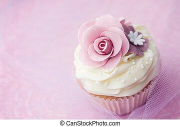 Wedding cupcake decorated with purple sugar flowers