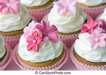 Wedding cupcakes decorated in different shades of pink