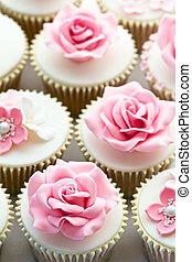 Wedding cupcakes decorated with sugar roses