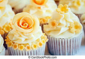 Wedding cupcakes - Cupcakes decorated with yellow sugar...