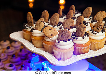 wedding cupcakes with chocolate chips and cookies during a catered event