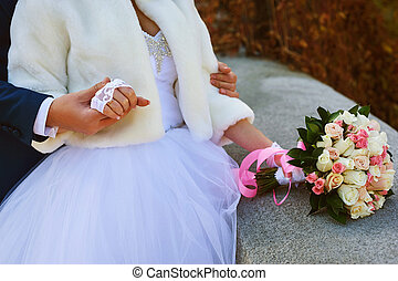 Wedding day. A beautiful bouquet in hand of bride