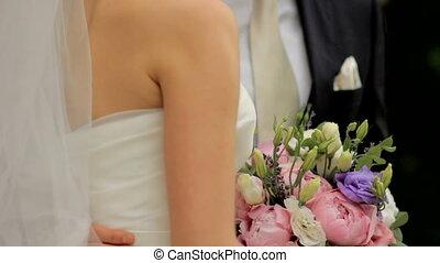 Wedding day. bridegroom embraces the tender bride's waist