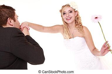 Wedding day. Male groom kissing hand of female bride.