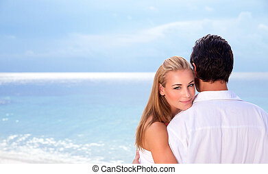Wedding day on seashore, young family on the beach ...