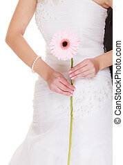 Wedding day. Pink flower gerbera in bride hand